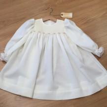 White long sleeved Smocked dress
